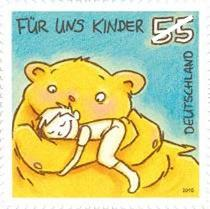 Bear hug picture from the series german stamps for children, showing a boy hugging his teddy bear.