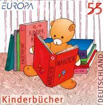 Teddy bear art from the series german stamps for children, showing a bear reading a book.